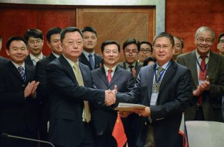 "This handout photo taken and released by the Philippine coast Guard-Public Information Office (PCG-PIO) on December 16, 2016 shows Philippine coast guard commander Commodore Joel Garcia (R) shaking hands with Chinese coast guard deputy director general Yun De (L) at the end of their meeting in Manila.  The Chinese and Philippine coast guards met for the first time on Friday and agreed to move forward on maritime cooperation, officials said, as relations between Beijing and Manila warm under Philippine President Rodrigo Duterte. / AFP PHOTO / PCG / HO / RESTRICTED TO EDITORIAL USE - MANDATORY CREDIT ""AFP PHOTO / PHILIPPINE COAST GUARD"" - NO MARKETING NO ADVERTISING CAMPAIGNS - DISTRIBUTED AS A SERVICE TO CLIENTS"