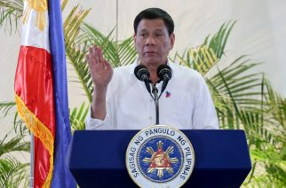 Philippine President Rodrigo Duterte gestures during a press conference shortly after arriving from Singapore at Davao international airport in southern island of Mindanao early December 17, 2016.   Duterte boasted again on December 16, he had killed criminals, as he vowed no let up in his war on drugs that has already claimed thousands of lives. But after flying home from Singapore to his southern hometown of Davao, Duterte outlined how, as city mayor in 1988, he and two policemen had shot dead three men who had collected a ransom payment for a kidnapped local woman. / AFP PHOTO / MANMAN DEJETO