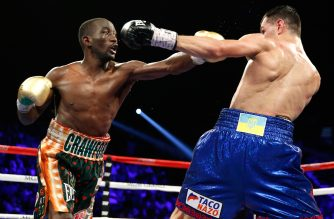 LAS VEGAS, NV - JULY 23: WBO junior weleterweight champion Terence Crawford (L) throws a punch at WBC champion Viktor Postol during their title unification fight at the MGM Grand Garden Arena on July 23, 2016 in Las Vegas, Nevada. Crawford won the fight by unanimous decision.   Steve Marcus/Getty Images/AFP
