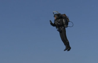 "Billed as ""the world's first true jetpack,"" JetPack Aviation shows off its JB-10 jet turbine-powered backpack, capable of vertical takeoff and landing. (Photo courtesy of Reuters video file)"