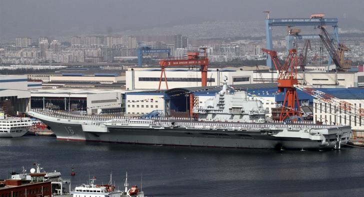 "A general view shows navy soldiers standing on China's first aircraft carrier ""Liaoning"" as it is berthed in a port in Dalian, northeast China's Liaoning province, September 25, 2012.  REUTERS/Stringer"