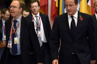 (FILES) In this file picture taken on  October 24, 2014, British Prime Minister David Cameron (R) and Britain's ambassador to the European Union, Ivan Rogers (L) leave European Union summit at EU headquarters in Brussels. Britain's ambassador to the European Union, Ivan Rogers, has resigned, Tuesday, January 3, 2017, less than three months before the UK is due to trigger the process to leave the bloc, a source told AFP. Rogers headed the United Kingdom Permanent Representation to the European Union (UKRep), which represents Britain in negotiations that take place in the EU. / AFP PHOTO / JOHN THYS