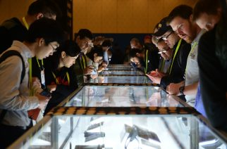 Attendees view a display of the CES Innovation Awards at the 2017 Consumer Electronic Show (CES) in Las Vegas, Nevada on January 8, 2017.    / AFP PHOTO / Frederic J. BROWN