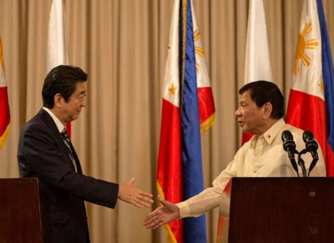 A meeting of friends: Japan PM Abe and Philippine President Duterte shake hands
