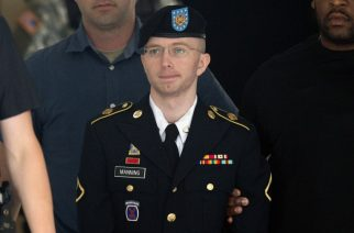 (FILES) This file photo taken on July 30, 2013 shows US Army Private First Class Bradley Manning leaving a military court facility after hearing his verdict in the trial at Fort Meade, Maryland. US President Barack Obama commuted the sentence of Manning a transgender woman now known as Chelsea Manning, who is serving 35 years behind bars for leaking classified US documents, the White House said January 17, 2017.  / AFP PHOTO / SAUL LOEB