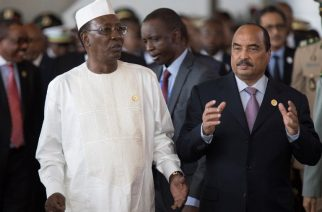 President of Chad and chairperson of the African Union, Idriss Deby Itno (L), speaks with Mohamed Ould Abdel Aziz, President of Mauritania, as they arrive for the 28th African Union summit in Addis Ababa on January 30, 2017. African Union leaders meet in Ethiopia on January 30 for a difficult summit likely to expose regional divisions as they debate whether to allow Morocco to rejoin the bloc, and vote for a new chairperson. / AFP PHOTO / ZACHARIAS ABUBEKER