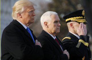 U.S. President-elect Donald Trump (L) and Vice President-elect Mike Pence (C) participate in a wreath laying ceremony at Arlington National Cemetery outside Washington, U.S., January 19, 2017, one day before Trump's inauguration as the nation's 45th president. REUTERS/Jonathan Ernst