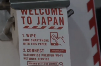 Japan's mobile phone company installs toilet rolls for smartphones at airport bathrooms.(photo grabbed from Reuters video)