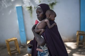 This photo taken on September 15, 2016 shows a mother holding her young malnourished baby at a public health facility in the Dalaram district of Maiduguri, northeast Nigeria.  Aid agencies have long warned about the risk of food shortages in northeast Nigeria because of the conflict, which has killed at least 20,000 since 2009 and left more than 2.6 million homeless. In July, the United Nations said nearly 250,000 children under five could suffer from severe acute malnutrition this year in Borno state alone and one in five -- some 50,000 -- could die.  / AFP PHOTO / STEFAN HEUNIS
