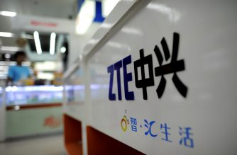 """A ZTE logo is diplayed on a sales counter in Wuhan, central China's Hubei province on October 8, 2012. Beijing on October 8 urged Washington to """"set aside prejudices"""" after a draft Congressional report said Chinese telecom firms Huawei and ZTE were security threats that should be banned from business in the US.   CHINA OUT      AFP PHOTO / AFP PHOTO / STR"""