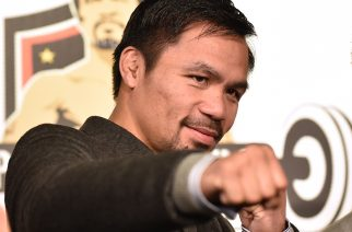 "WBO welterweight world champion Manny Pacquiao poses for the media following a press conference at his boxing gym in Tokyo on November 25, 2016. WBO welterweight world champion Manny Pacquiao on November 25 kept alive hopes for a rematch with Floyd Mayweather, saying the epic clash was ""possible"" but only if his arch rival returns to the ring. / AFP PHOTO / KAZUHIRO NOGI"