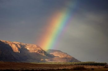Featured Photo: Rainbow rises from the mountains in West Bank part of Dead Sea