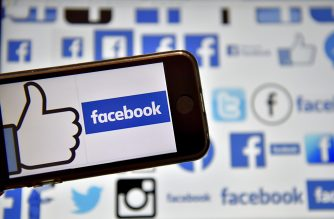 """(FILES) This file photo taken on December 28, 2016  shows logos of US online social media and social networking service Facebook in Vertou, western France. Facebook on February 8, 2017 updated its Safety Check feature with a way for people to lend, or get, helping hands after disasters. A new """"Community Help"""" feature provides a forum at the leading social network where assistance can be offered to victims of floods, earthquakes, fires or other kinds of natural or accidental tragedy, according to Facebook vice president of social good Naomi Gleit.  / AFP PHOTO / LOIC VENANCE"""