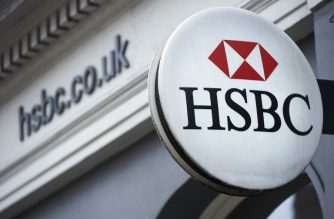 A HSBC bank logo is seen on a sign outside a branch of the bank in central London on February 21, 2017. HSBC profits plunged last year on huge writedowns and restructuring charges, the banking titan said on February 21, warning of uncertainty over Brexit and Donald Trump's economic policies.  / AFP PHOTO / NIKLAS HALLE'N