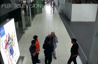 """This screengrab made from CCTV footage obtained by Fuji TV and taken on February 13, 2017  shows Kim Jong-Nam (C in grey suit), half-brother of North Korea's leader Kim Jong-Un, speaking to airport authorities at the Kuala Lumpur International Airport in Kuala Lumpur. Malaysian investigators want to question a North Korean diplomat over the assassination of Kim Jong-Un's half-brother in Kuala Lumpur, national police chief Khalid Abu Bakar said on February 22.  / AFP PHOTO / Fuji TV / Handout /  - Japan OUT / RESTRICTED TO EDITORIAL USE - MANDATORY CREDIT """"AFP PHOTO/Fuji TV"""" - NO MARKETING NO ADVERTISING CAMPAIGNS - DISTRIBUTED AS A SERVICE TO CLIENTS - NO ARCHIVE"""