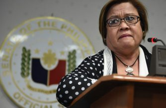 Philippine Senator Leila De Lima (R), a top critic of President Rodrigo Duterte, holds back tears as she speaks during a press conference in the senate in Manila on February 23, 2017, as she awaits the warrant of arrest to be served.  / AFP PHOTO / TED ALJIBE