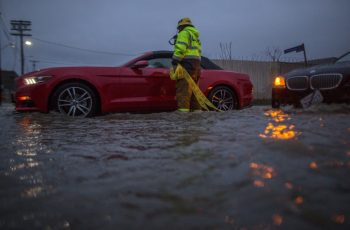 SUN VALLEY, CA - FEBRUARY 17: A firefighter checks on stalled cars in a flooded street as a powerful storm moves across Southern California on February 17, 2017 in Sun Valley, California. After years of severe drought, heavy winter rains have come to the state, and with them, the issuance of flash flood watches in Santa Barbara, Ventura and Los Angeles counties, and the evacuation of hundreds of residents from Duarte, California for fear of flash flooding from area denuded by a wildfire last year.   David McNew/Getty Images/AFP