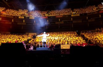 Performing as the biggest school choir in the world, over 7,500 primary school students took part during this music extravaganza at the O2 Arena in London. (Photo by EBC London Bureau)