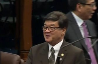 (File photo) Justice Secretary Vitaliano Aguirre II smiles as he is congratulated by senators and lawmakers after he was confirmed at the Commission on Appointments.