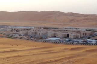"A picture taken on May 10, 2016 shows over Shaybah, the base for Saudi Aramco's Natural Gas Liquids plant and oil production in the surrounding Shaybah field in Saudi Arabia's remote Empty quarter desert close to the United Arab Emirates, on May 10, 2016. Despite collapsed global oil prices, production is expanding at Shaybah, as it is in other units of the company at the centre of the kingdom's Vision 2030 drive for diversification away from oil. The Saudi government plans to sell less than five percent of the company in what officials say will be the world's largest-ever share offering, while transforming Saudi Aramco into ""a global industrial conglomerate"". By 2020 the company says it will have tripled its gas processing capacity from levels at the turn of the century. / AFP PHOTO / IAN TIMBERLAKE"
