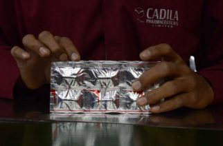 An Indian employee from Cadila Pharmaceuticals Limited packs strips of Risorine capsules at their manufacturing facility on World Tuberculosis (TB) Day in Dholka, some 40 kms from Ahmedabad on March 24, 2015   Risorine, which uses lesser doses of anti-TB drug Rifampicin but with higher efficacy developed indigenously by Indian scientists, could cut short the duration of TB treatment. The World Health Organization has included India on the list of high-burdened countries that contribute to 80 percent of the world's TB problem. AFP PHOTO / Sam PANTHAKY / AFP PHOTO / SAM PANTHAKY