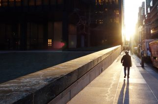 A man walks down a sidewalk on the east side of Manhattan as the sun rises January 19, 2017 in New York. / AFP PHOTO / Don EMMERT