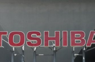 The Toshiba Corporation logo is seen at the company's headquarters in Tokyo on February 16, 2017.  Shares in Toshiba fell 1.95 percent to 205.6 yen after losing 16 percent the previous two days as fears mount over massive losses from its US nuclear power business. / AFP PHOTO / KAZUHIRO NOGI