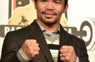 "(FILES) This file photo taken on November 25, 2016 shows WBO welterweight world champion Manny Pacquiao posing for the media following a press conference at his boxing gym in Tokyo. Philippine boxing hero Manny Pacquiao on February 23, 2017 said he was ""in negotiations"" to face British fighter Amir Khan, after weeks of conflicting reports over his next bout. / AFP PHOTO / KAZUHIRO NOGI"