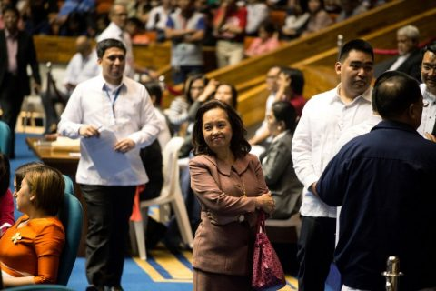 Former Philippines president and congresswoman Gloria Macapagal Arroyo (C) stands in the House of Representatives as Congress prepares to vote regarding the passage of the death penalty in Manila on March 1, 2017. The lower house of the Philippine parliament on March 1 voted on the passage of a bill reimposing the death penalty for narcotics trafficking. / AFP PHOTO / Noel CELIS