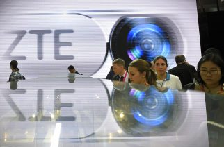 (FILES) This file photo taken on February 23, 2016 shows visitors testing smart phones at the ZTE's stand during the Mobile World Congress in Barcelona. The US government has slapped $1.2 billion in fines on Chinese telecom giant ZTE for violations of US export controls for selling goods to Iran and North Korea, officials announced on March 7, 2017. It is the largest criminal penalty in US history in an export control case, government officials said. The company will pay $892 million, while another $300 million in penalties are suspended for seven years. ZTE also agreed to plead guilty to three charges, including obstructing justice for hiding information from government investigators, the officials said. The agreement is subject to court approval.  / AFP PHOTO / LLUIS GENE
