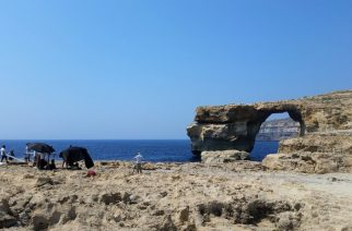 A picture taken on July 21, 2017 in Malta shows the Azure Window, a limestone arch on Gozo island. Gale force winds and high waves have destroyed the iconic Azure Window on the island of Gozo, Malta's sister island. The Azure Window has represented Gozo and the island's enduring raw beauty for many years and is believed to have formed about in the mid 19th century. The massive arch landmark with its flat top over the sea at Dwejra, endured raging seas but the storms that hit Malta and Gozo in the last couple of days swept the entire structure away at 9.40am on Wednesday. No one was injured.    / AFP PHOTO / Amélie BOTTOLLIER-DEPOIS