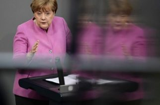 """German Chancellor Angela Merkel is reflected in a glass surface during her speech at a session of the German lower house of parliament Bundestag in Berlin on March 9, 2017.  Chancellor Angela Merkel said that Germany must not allow Turkey to """"grow more distant"""", despite a bitter row in which President Recep Tayyip Erdogan has likened her government to the Nazis. / AFP PHOTO / Tobias SCHWARZ"""