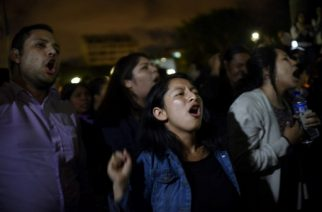 People shout slogans demanding the resignation of Guatemalan President Jimmy Morales during a demonstration outside the Culture Palace in Guatemala City on March 9, 2017, following the death of 34 girls in a recent fire at a government-run children's shelter in San Jose Pinula, east of the capital. Guatemala recoiled in anger and shock Thursday at the deaths of 34 teenage girls in a fire at a government-run shelter where staff have been accused of sexual abuse and other mistreatment. Around 20 more survivors remained hospitalized, most of them in critical condition, according to hospital officials. / AFP PHOTO / JOHAN ORDONEZ