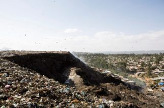 A photo taken on March 12, 2017 shows a view of the main landfill of Addis Ababa on the outskirts of the city, after a landslide at the dump left at least 30 people dead. At least 30 people died and dozens more were hurt in a giant landslide at Ethiopia's largest rubbish dump outside Addis Ababa, a tragedy squatters living there blamed on a biogas plant being built nearby. The landslide late on March 11 saw dozens of homes of people living in the dump levelled after a part of the largest pile of rubbish at the Koshe landfill collapsed, an AFP journalist said.  / AFP PHOTO / ZACHARIAS ABUBEKER