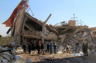 """(FILES) This file photo taken on February 15, 2016 shows people gathering around the rubble of a hospital supported by Doctors Without Borders (MSF) near Maaret al-Numan, in Syria's northern province of Idlib,  after the building was hit by suspected Russian air strikes.  More than 800 health workers have died in """"acts of war crimes"""" in Syria since 2011, in hospital bombings, shootings, torture and executions perpetrated mainly by government-backed forces, researchers said on March 15, 2017. / AFP PHOTO / AL-MAARRA TODAY / GHAITH OMRAN"""