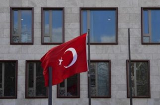 """The Turkish flag flies in front of the Turkish embassy in Berlin on March 15, 2017. Turkey has been waging a war of words with its NATO partner Germany, with President Recep Tayyip Erdogan accusing it of """"Nazi practices"""" after several German towns blocked rallies by Turkish ministers campaigning in favour of the referendum to expand the president's powers. / AFP PHOTO / John MACDOUGALL"""