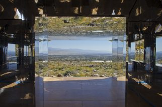"Doug Aitken's Mirage house from the Desert X land art exhibit in the Coachella Valley of California is viewed on March 16, 2017.  A house made of mirrors pops out of the California desert. It blends into the landscape, reflecting in kaleidoscope the urban grid and arid valley of Palm Springs -- to the delight of photographers and selfie-seekers.This is Doug Aitken's ""Mirage,"" one of the showstoppers of ""Desert X,"" an exhibition that brings together 16 monumental works by international artists and spans southern California's Coachella Valley.  / AFP PHOTO / Konrad Fiedler / TO GO WITH AFP STORY by Veronique Dupont -""'Desert X' exhibit reflects earth, sky, state of the world"" RESTRICTED TO EDITORIAL USE - MANDATORY MENTION OF THE ARTIST UPON PUBLICATION - TO ILLUSTRATE THE EVENT AS SPECIFIED IN THE CAPTION"