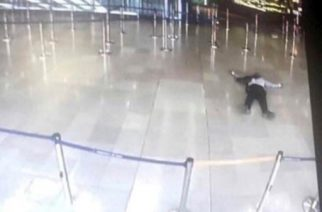 A picture taken from the screen of a monitor on March 18, 2017 shows a man lying on the ground  of a terminal building at Paris' Orly airport after he was shot by French security forces for taking a weapon from a soldier.   Security forces at Paris' Orly airport shot dead a man who took a weapon from a soldier, the interior ministry said. Witnesses said the airport was evacuated following the shooting at around 8:30am (0730GMT). The man fled into a shop at the airport before he was shot dead, an interior ministry spokesman told AFP. He said there were no people were wounded in the incident.  / AFP PHOTO / - / ALTERNATIVE CROP