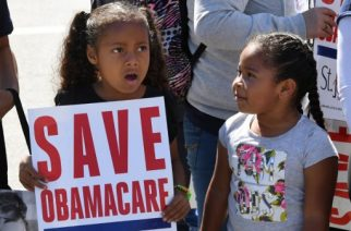 """Young protesters march towards the Federal Building during a """"Save the Affordable Care Act"""" rally in Los Angeles, California on March 23, 2017.  The march coincides with the seventh anniversary of Obamacare.  / AFP PHOTO / Mark RALSTON"""