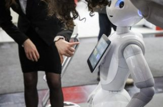 "(FILES) This file photo taken on March 20, 2017 shows  a robot interacting with visitors at the Soft Bank robotics stand at the Cebit technology fair in Hanover, Germany.   Technology has long impacted the labor force, but recent advances in artificial intelligence and robotics have heightened concerns on automation replacing a growing number of occupations including  highly skilled or ""knowledge-based"" jobs. / AFP PHOTO / Odd ANDERSEN / TO GO WITH AFP STORY by Rob LEVER, US IT lifestyle labor robots"