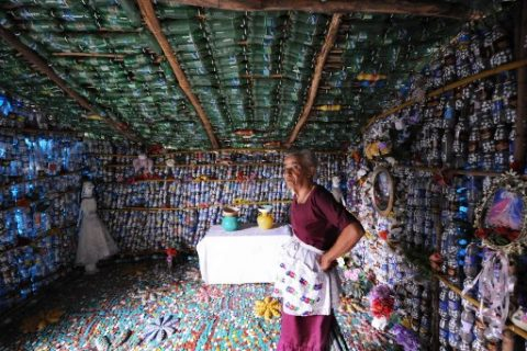 Maria Ponce, 76, stands inside her house made out of plastic bottles, in the village of El Borbollon, San Miguel Province, El Salvador, 125 kilometres from San Salvador on April 2, 2007. Maria built up the house four years ago with plastic bottles because she did not have enough money to make it in the usual way. AFP PHOTO/Jose CABEZAS / AFP PHOTO / Jose CABEZAS