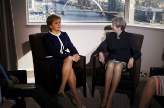 Britain's Prime Minister Theresa May (R) and Scotland's First Minister Nicola Sturgeon pose for a photograph ahead of their meeting in a hotle in Glasgow, on March 27, 2017. British Prime Minister Theresa May travelled to Scotland on Monday to try to avert its independence bid while also fighting a political crisis in Northern Ireland in the frantic final days before she launches Brexit. / AFP PHOTO / POOL / RUSSELL CHEYNE