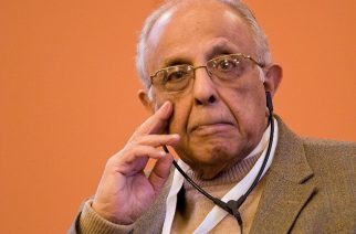 (FILES) This file photo taken on November 10, 2009 shows anti-apartheid activist Ahmed Kathrada listening to a speech at the 10th World Summit of Nobel Peace Laureates at the Rotes Rathaus (City Hall) in Berlin. Leading South African anti-apartheid activist Ahmed Kathrada, who was one of Nelson Mandela's closest colleagues, died early on March 28, 2017 aged 87, Kathrada's charity foundation said. / AFP PHOTO / Leon NEAL