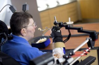 """This handout image released on March 29, 2017 by The Lancet journal shows 56-year-old US Bill Kochevara, paralysed from the shoulders down, feeding himself. Over a decade after a bike crash that left an American man paralysed from the shoulders down, he can again feed himself, researchers hailing a medical first reported. The remarkable advance hinges on a prosthesis which circumvents rather than repairs his spinal injury, using wires, electrodes as well as computer software to reconnect the severed link between his brain and muscles.  / AFP PHOTO / THE LANCET / Handout / RESTRICTED TO EDITORIAL USE - MANDATORY CREDIT """"AFP PHOTO / THE LANCET /  Case Western Reserve University """" - NO MARKETING NO ADVERTISING CAMPAIGNS - DISTRIBUTED AS A SERVICE TO CLIENTS"""