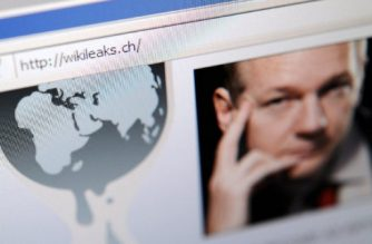 The homepage of Wikileaks.ch with a picture of its founder Julian Assange is seen on a computer screen on December 4, 2010 in Lausanne. WikiLeaks was battling to stay online after Sweden issued a new arrest warrant for its elusive boss Julian Assange, while PayPal axed donations access for the whistleblowing website. The Swiss address -- wikileaks.ch -- was up and running again after migrating to new servers.   AFP PHOTO / FABRICE COFFRINI / AFP PHOTO / FABRICE COFFRINI
