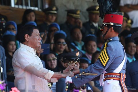 President Rodrigo Duterte awards the Philippine Navy Saber to Philippine Military Academy (PMA) 'Salaknib' Class of 2017 top graduate Cadet First Class Rovi Mairel Valino Martinez during the Commencement Exercises at the Fort General Gregorio H. del Pilar in Baguio City on March 12, 2017.  (Photo courtesy Presidential Communications)