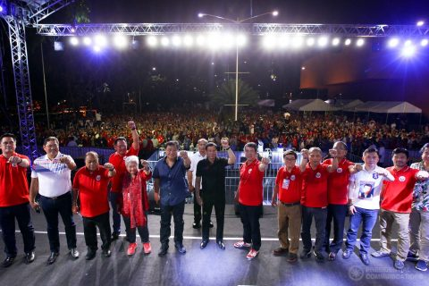 President Rodrigo Duterte, members of the Cabinet, and officers of the Partido Demokratiko Pilipino (PDP) pose for a photo on stage with party members and supporters on their background during the PDP 35th anniversary celebration at the Philippine International Convention Center (PICC) Grounds in Pasay City on March 12, 2017.  (Photo courtesy Presidential Communications)