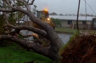 Australia's army and emergency workers headed to areas of tropical Queensland state hardest hit by Cyclone Debbie, finding roads blocked by fallen trees and widespread damage in coastal towns.(photo grabbed from Reuters video)