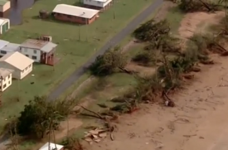 Australian Prime Minister Malcolm Turnbull visits cyclone-ravaged areas in Queensland, as flooding intensifies in the southeast. (Photo grabbed from Reuters video)