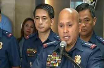 "Philippine National Police chief Director General Ronald ""Bato"" dela Rosa announces the return of a ""less bloody"" war on drugs of the national police, entitled ""Oplan Tokhang Revisited.""  Behind him is Senior Supt. Graciano Mijares who will head the newly formed PNP Drug Enforcement Group (PNP-DEG) which will handle the PNP's drug operations.  (Eagle News Service)"